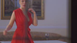 Beautiful lonely woman dancing in the room