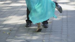 Beautiful senior woman and man are dancing waltz