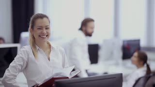 Beautiful smiling businesswoman in the office