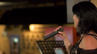 Beautiful woman singing at restaurant