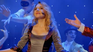 Beautiful woman sings song and plays her scenic role in the theatre