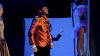 Beautiful woman sings song with handsome man on the stage in theatre