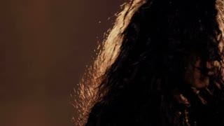 Beautiful woman with creepy facial greasepaint