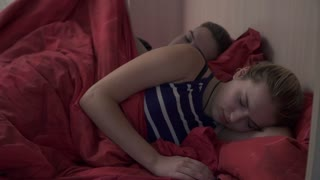 Beautiful young couple in the morning in bed in the bedroom at home