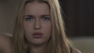 Beautiful young girl is upset and shows emotions