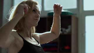 Beautiful young woman stretching her body before training