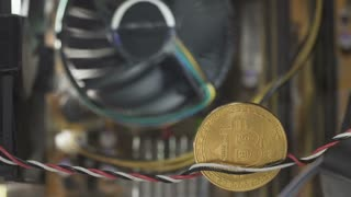Bitcoin in close-up, the cooler circling on blurred background