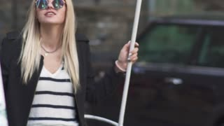 Blond girl swings at the street
