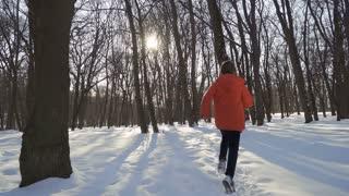 Boy run in slow motion in winter park
