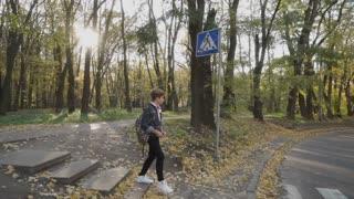 Boy walks on the crosswalk