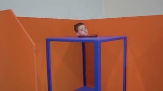 Boy's head inside the magic cube