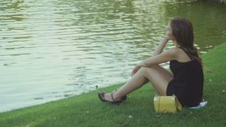Brunette relaxing near the water