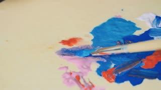 Brush mix paints on palette