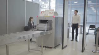 Businessman check a luggage on the x-ray machine and go through x-ray checkpoint