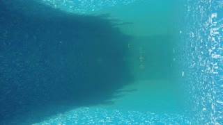 Businessman dives under water in suit