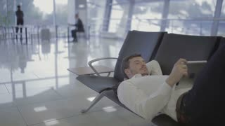 Businessman forgets jacket in the airport hall at the airport