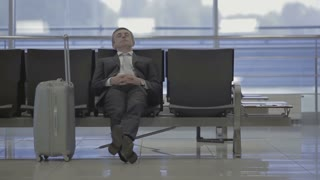 Businessman in the airport waiting walks to the gate