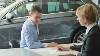 Businessman sign the papers on buying a car