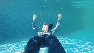 Businessman swims under water in slowmotion