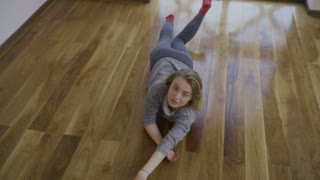 Charming blonde dance on floor at home in slowmotion