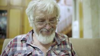 Cheerful senior man at home