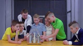 Children explore wimshurst machine in scientific museum