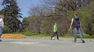 Children plays football in park