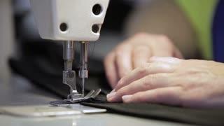 Close up of a sewing machine sews