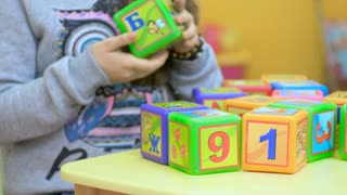 Close-up of children playing with cubes