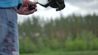 Close-up of moving fishing line on the spinning