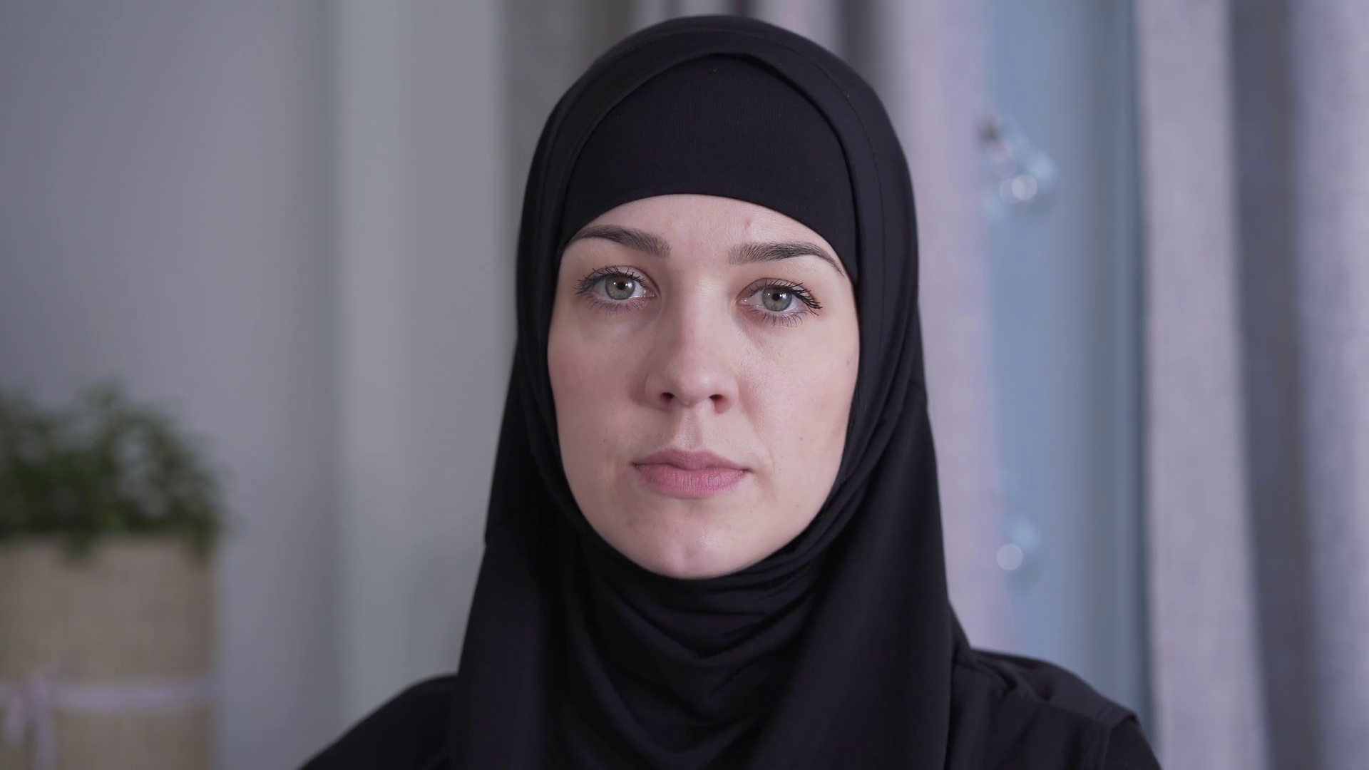 Close-up portrait of young beautiful Muslim woman in traditional black hijab. Charming lady looking at camera. Beauty, style, culture, lifestyle. Stock Video Footage - Storyblocks