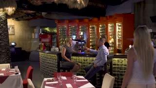 Company meet at bar in restaurant