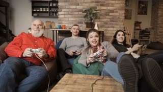Company of friends plays video game together