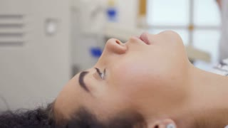 Concentrated woman during ultrasound survey
