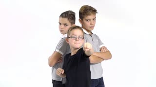Cool gang of three brothers at white background