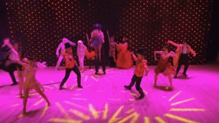 Crazy dancers at colorful stage