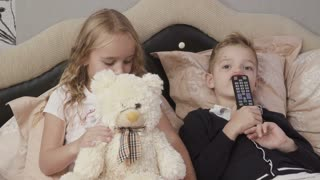Cute children watches TV