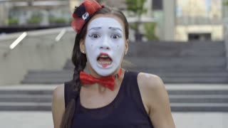 Cute girl mime scared from something