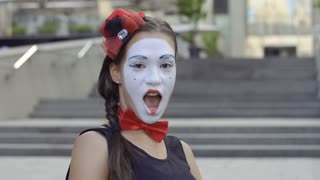 Cute girl modest mime posing for camera