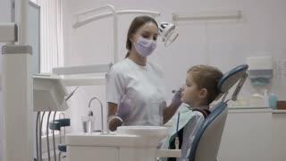 Cute little boy on dentist's reception