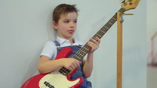 Cute little boy with electronic guitar