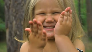 Cute little girl close her face with hands