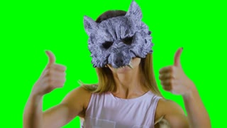 Dancing wolf with thumbs up at green background