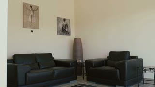 Design of living room with two sofas and pictures on wall