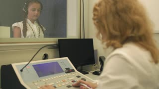 Doctor checks the hearing with equipment