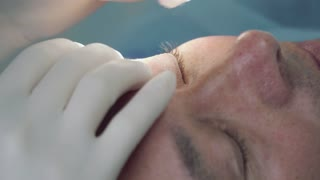 Doctor disinfect the skin of patient before the procedure