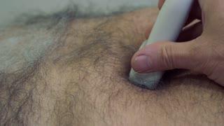 Doctor examine abdomen of mature man with ultrasound equipment