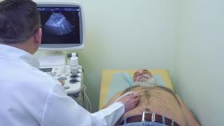 Doctor make ultrasonography of abdomen to a senior man