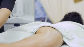 Doctor massages woman's buttocks with lpg apparatus