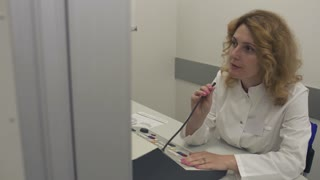 Doctor says in the microphone to the patient